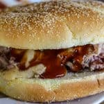pulled pork sandwich with smoked cheese sauce
