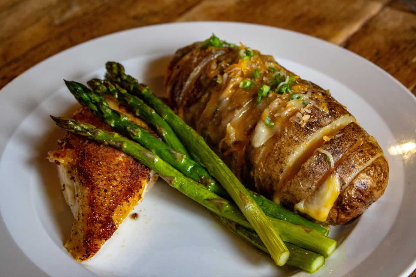 Smoked Whole Chicken Breast with Asparagus and Hasselback Potatoes
