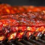 2 racks of Honey Garlic Pork Ribs on a grill grate