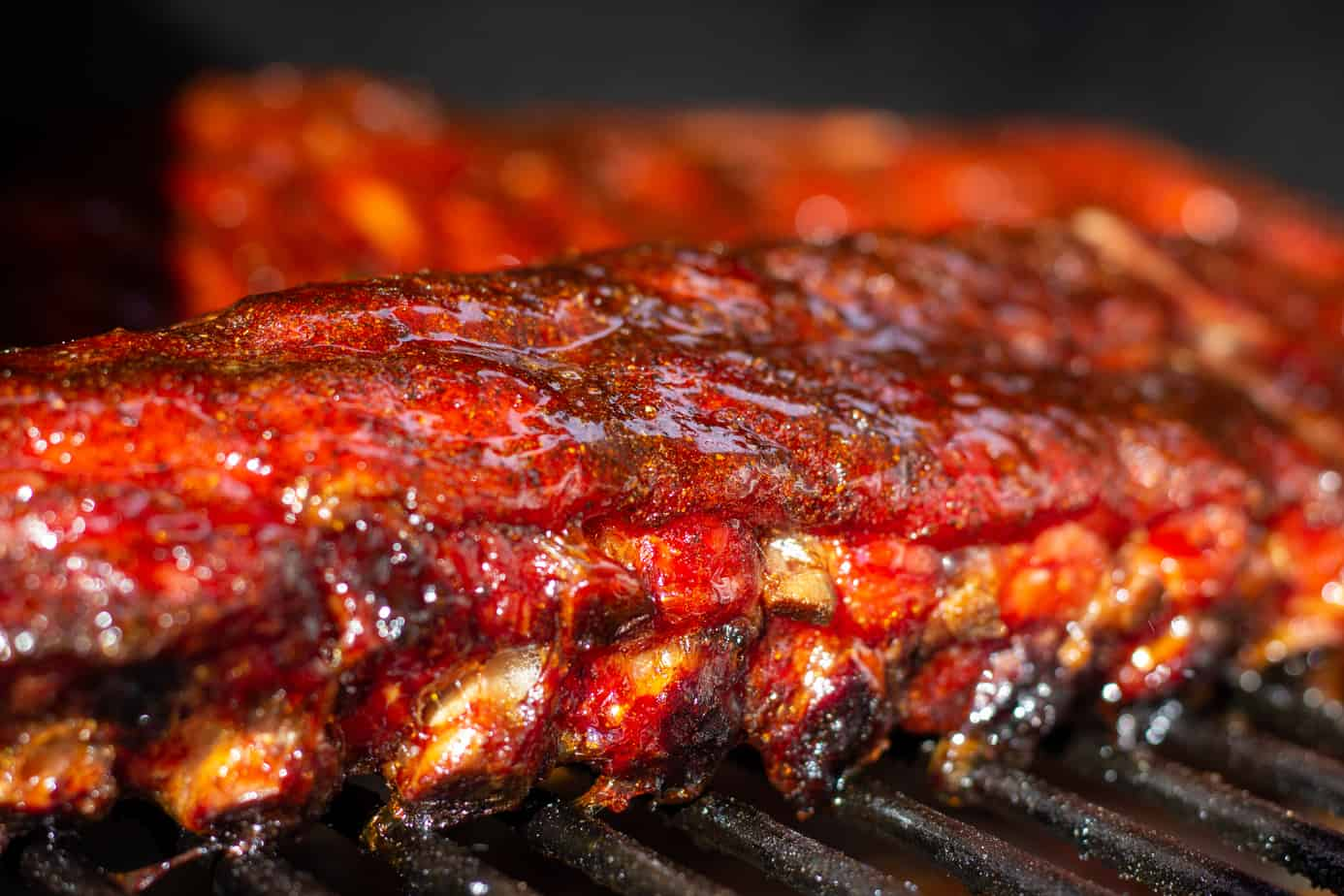 2 racks of Honey Garlic Pork Ribs on a grill grate