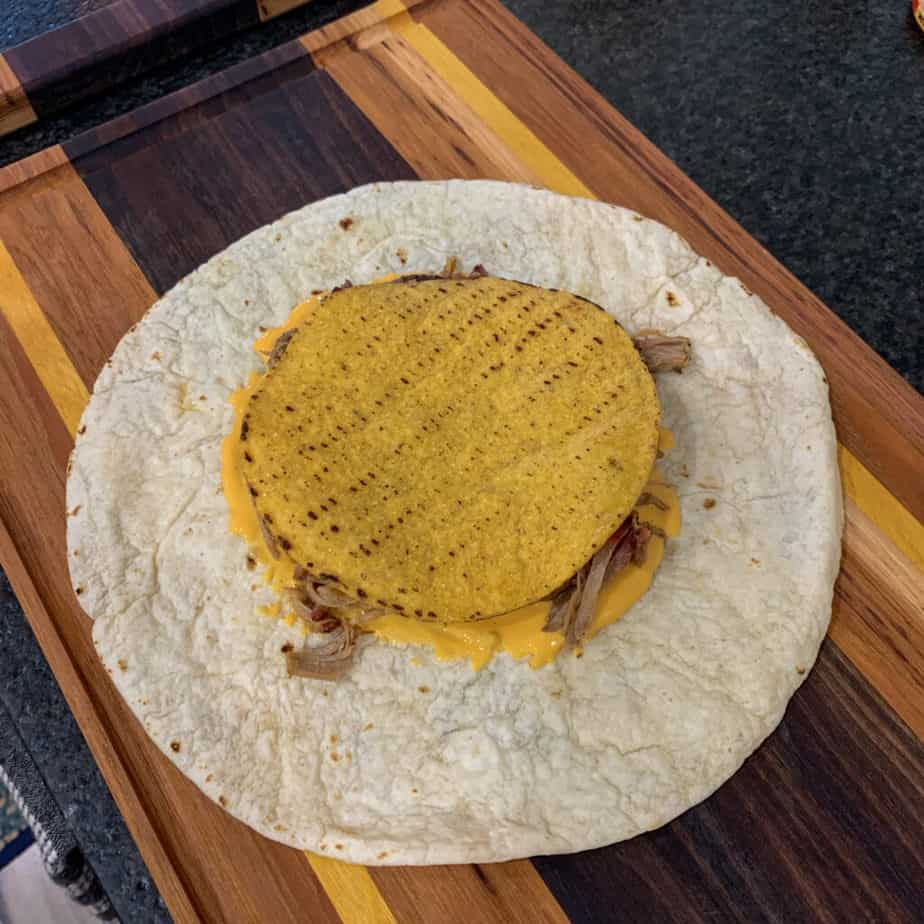 tostada shell over toppings and a tortilla