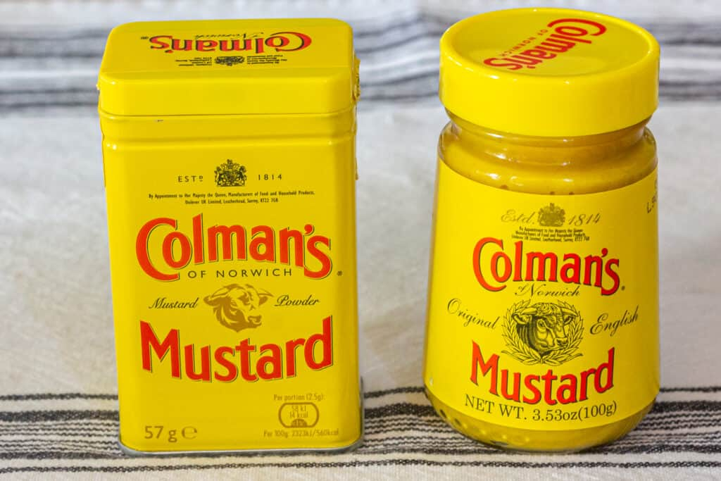 Containers of Colman's Dry Mustard and Colman's Prepared Mustard