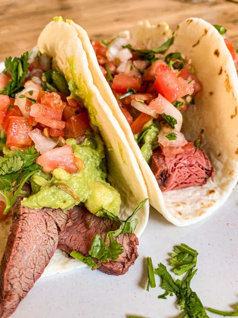flank steak tacos with pico de gallo and guacamole