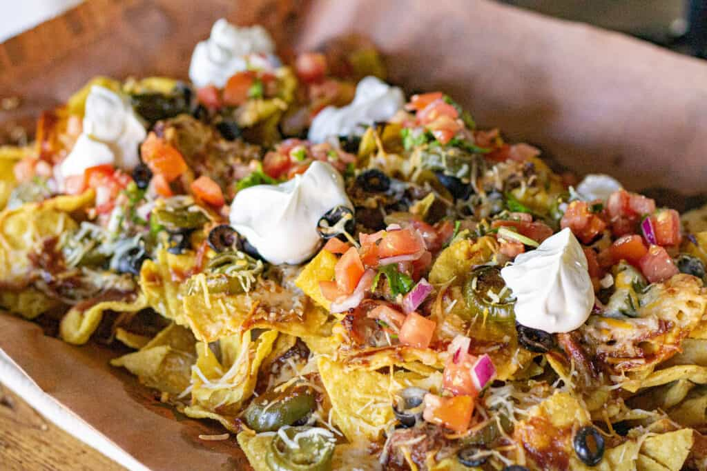 pulled pork nachos on a baking sheet