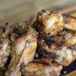 spicy peanut butter chicken wings on a cutting board