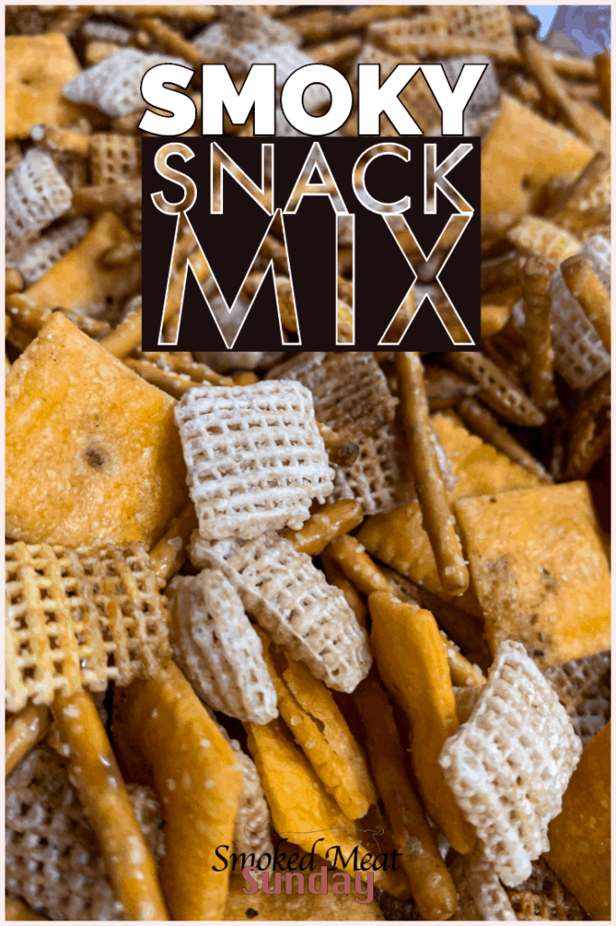 If you love chex mix, you'll love this smoky snack mix recipe. It has all the great taste of chex mix, with a wood fired smoky kiss that takes the flavor over the top. This smoked snack mix is great for a family get together, tailgate party, or just to have on hand when you need a snack. #traeger #appetizers #bbqsnacks #traegerrecipes