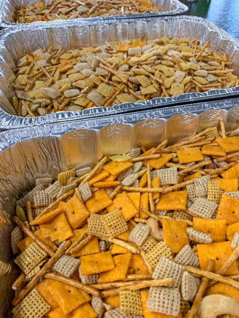 smoky snack mix recipe - placing ingredients in each of the three pans
