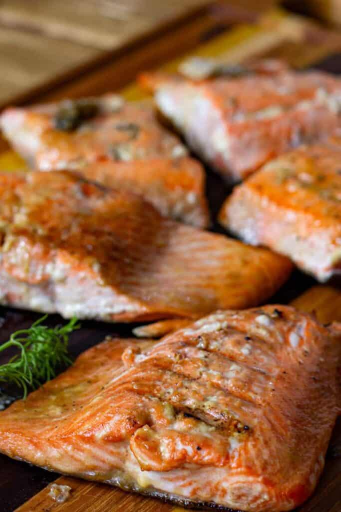 grilled salmon fillets on a cutting board