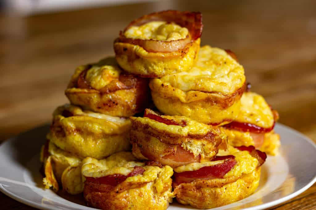 smoked bacon egg and cheese bites in a pile on a plate