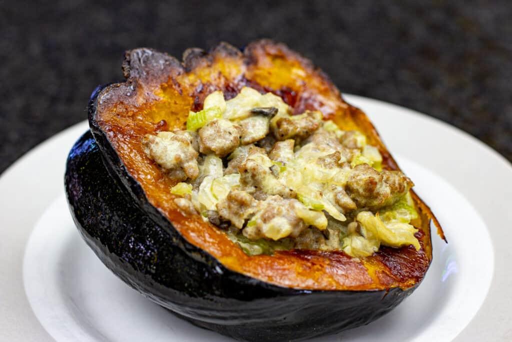 sausage stuffed acorn squash on a plate